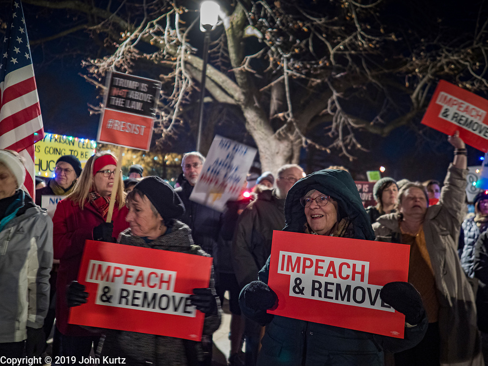 17 DECEMBER 2019 - DES MOINES, IOWA: About 300 people came to the Iowa State Capitol in Des Moines in near freezing weather Tuesday evening to call for President Donald Trump's impeachment. The rally, and others like it around the US, come on the eve of an impeachment vote in the US House of Representatives.    PHOTO BY JACK KURTZ