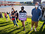 29 MAY 2020 - DES MOINES, IOWA: Black Live Matter supporters at a vigil for George Floyd in Des Moines Friday evening. About 1,000 people attended the vigil. Floyd, a 46 year old unarmed African-American man, was killed by four Minneapolis police officers Monday evening May 25. The four police officers were fired from the Minneapolis Police Department. Officer Derek Chauvin, seen in videos with his knee on Floyd's neck, was charged with third-degree murder and second-degree manslaughter on Friday in Floyd's death. The death of George Floyd, while he was restrained and in police custody, has set off protests and vigils across the US.         PHOTO BY JACK KURTZ