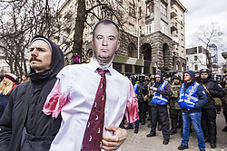 March 23, 2019 - Kiev, Kiev, Ukraine - Protester with a mannequin of First Deputy Chairman of the National Security and Defence Council O. Gladkovsky during a demonstration against Ukrainian government corruption in Kiev. (Credit Image: © Celestino Arce Lavin/ZUMA Wire)