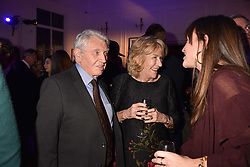Don McCullin and Annabel Elliot at Mark Shand's Adventures and His Cabinet Of Curiosities VIP private view, 32 Portland Place, London, England. 20 February 2018.