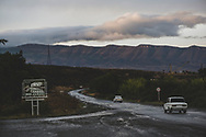 Cars drive at the end of a day on a highway just outside the city of Stepanakert in Nagorno-Karabakh.<br /> <br /> (September 24, 2016)