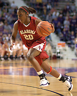 Oklahoma guard Kendra Moore drives to the basket against Kansas State, during the first half at Bramlage Coliseum in Manhattan, Kansas, February 21, 2006.  The 9th ranked Sooners defeated K-State 78-64.