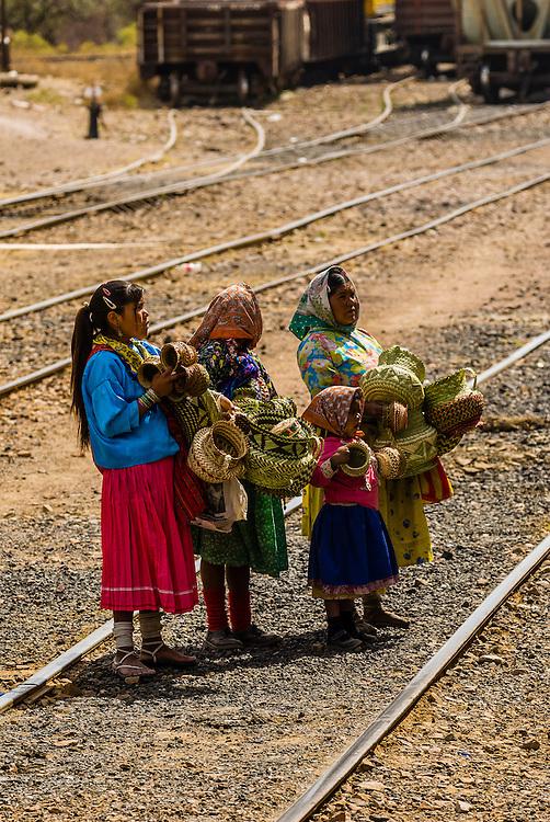 Tarahumara Indian woman and girl selling handwoven baskets at the train station, San Rafael, Copper Canyon, Mexico