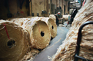 A worker sweeping the factory floor at Tay Spinners mill in Dundee, Scotland. This factory was the last jute spinning mill in Europe when it closed for the final time in 1998. The city of Dundee had been famous throughout history for the three 'Js' - jute, jam and journalism.