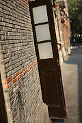 A woman hides from the photographer in Xintiandi neighborhood in Shanghai, China, on October 16, 2007. Photo by Lucas Schifres/Pictobank