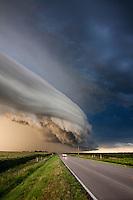 An arcus cloud pushes across the highway north of Kearney, Nebraska, August 8, 2011.
