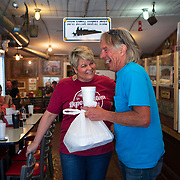 Owner Suzanne Moore Prater talks jokes with Randy Byars at the Depot Bottom Country Store in McMinnville, Tennessee. Nathan Lambrecht/Journal Communications