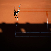 PARIS, FRANCE June 10. Maria Sakkari of Greece serving against Barbora Krejcikova of the Czech Republic as the early evening shadows creep across Court Philippe-Chatrier during the semi finals of the Women's singles competition at the 2021 French Open Tennis Tournament at Roland Garros on June 10th 2021 in Paris, France. (Photo by Tim Clayton/Corbis via Getty Images)