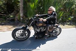 Arlen Ness riding through Tamoka State Park during the Daytona Bike Week 75th Anniversary event. FL, USA. Monday March 7, 2016.  Photography ©2016 Michael Lichter.