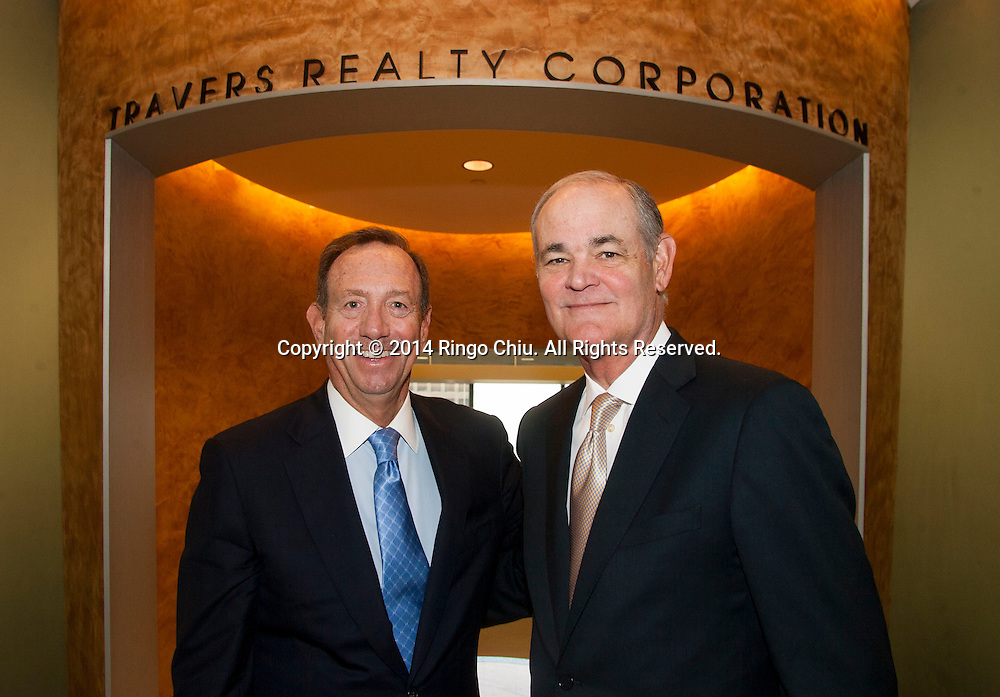 Jerry Porter, right, and Jim Travers of Travers Realty Corp. Jerry and Jim are merging their two real estate brokerage firms after having been competitors for decades.<br /> (Photo by Ringo Chiu/PHOTOFORMULA.com)