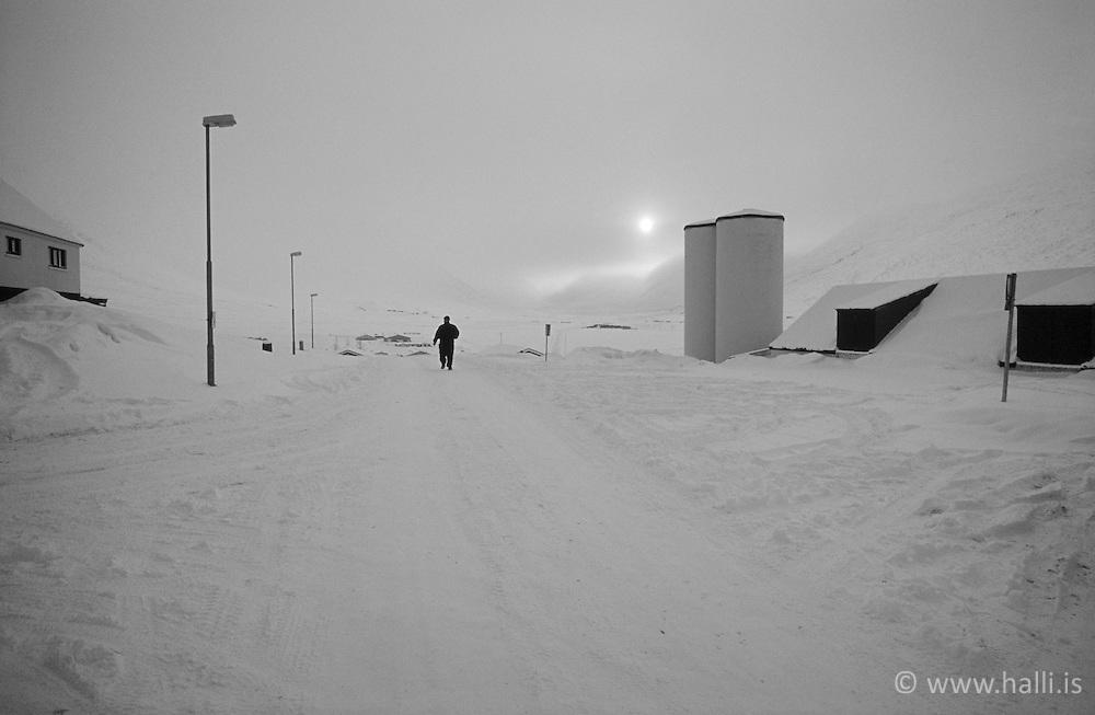 Man walking in snow at Holar in Hjaltadalur, north Iceland - Maður á gangi að vetri við Hóla í Hjaltadal