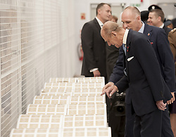 File photo dated 30/10/14 of the Duke of Edinburgh examining large rolls of stamps during an official visit to International Security Printers in Wolverhampton to view their work on specialist postage stamps. The Duke of Edinburgh has died, Buckingham Palace has announced. Issue date: Friday April 9, 2020.. See PA story DEATH Philip. Photo credit should read: Richard Stonehouse/PA Wire