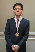 Oscar Wu poses for a photograph during the Scholars banquet, April 12, 2016.