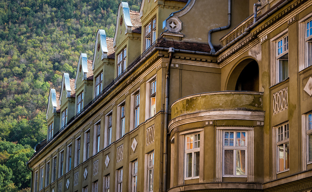 View of typical facades of historic buildings in Brasov, Romania