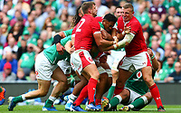 Rugby Union - 2019 pre-Rugby World Cup warm-up (Guinness Summer Series) - Ireland vs. Wales<br /> <br /> Bundee Aki (Ireland) is held up by Dan Biggar (Wales) and Hadleigh Parkes (Wales) at The Aviva Stadium.<br /> <br /> COLORSPORT/KEN SUTTON