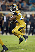 Jacksonville Jaguars running back T.J. Yeldon (24) jumps in the air as he makes a cut on a fourth quarter running play during the 2015 week 11 regular season NFL football game against the Tennessee Titans on Thursday, Nov. 19, 2015 in Jacksonville, Fla. The Jaguars won the game 19-13. (©Paul Anthony Spinelli)