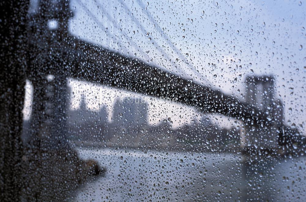 Manhattan bridge through a window in the rain