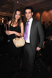 JOHN KRASNER and Louise Bologna at the Liberatum Dinner hosted by Ella Krasner and Pablo Ganguli in honour of Sir V S Naipaul at The Landau at The Langham, Portland Place, London on 23rd November 2010.