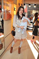 LAUREN KEMP and her son REX at a fun filled tea party hosted by Roger Vivier to view their Jeune Fille collection of shoes in aid of Mothers4Children held at Roger Vivier, Sloane Street, London on 27th March 2012.