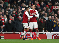 Arsenal's Alexis Sanchez (left) celebrates scoring his side's second goal of the game with Mesut Ozil during the Premier League match at the Emirates Stadium, London.