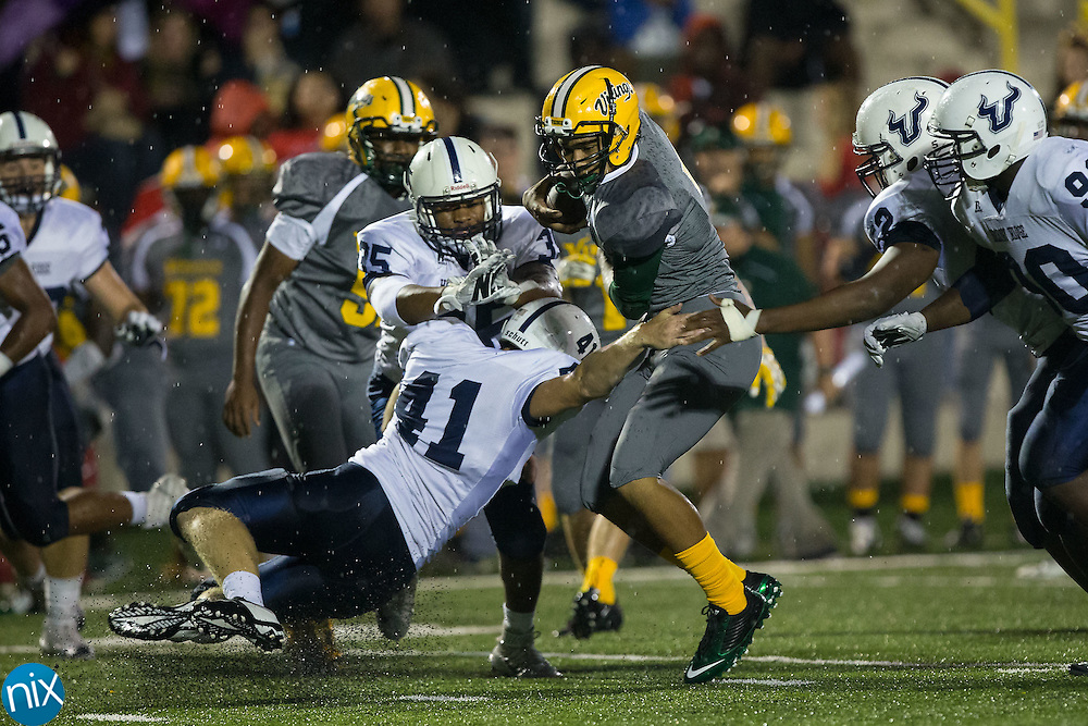 Tyler English (7) of the Central Cabarrus Vikings avoids the arm tackle attempt by Jack Wallace (41) of the Hickory Ridge Ragin' Bulls during first half action at Central Cabarrus High School on September 25, 2015 in Concord, North Carolina.  The Ragin' Bulls defeated the Vikings 41-12.  (Brian Westerholt/Special to the Tribune)