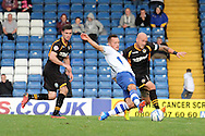 Newport County's David Pipe challenges Bury's Shaun Harrad (c) for the  ball. Skybet Football League two match, Bury v Newport county at Gigg Lane in Bury on Saturday 5th Oct 2013. pic by David Richards, Andrew Orchard sports photography,