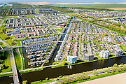 Nederland, Flevoland, Almere, 07-05-2015;  Almere-Buiten, Eilandenbuurt eengezinswoningen en stadsvilla's omgeven door waterpartijen.<br /> Eilandenbuurt (Island Area), town houses and urban villas surrounded by water.<br /> luchtfoto (toeslag op standard tarieven);<br /> aerial photo (additional fee required);<br /> copyright foto/photo Siebe Swart
