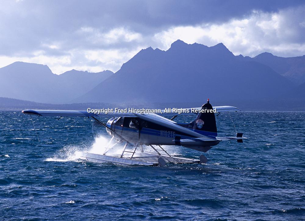 Crystal Creek Lodge's de Havilland Beaver taxiing into headwind on Nunavaugagluk Lake, Alaska.