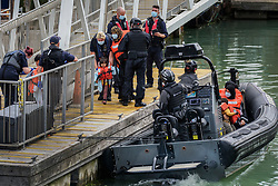 © Licensed to London News Pictures. 25/07/2021. Dover, UK. Migrants arrive ashore on a Border Force boat at Dover Harbour in Kent after crossing the English Channel. Hundreds of migrants have made the crossing in the calm weather this week. Photo credit: Stuart Brock/LNP