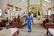 Nurse Christine Happy walks through the children's ward checking on patients at Bwindi Community hospital, Uganda. Standards of patient care and cleanliness at the hospital are extremely high. The Bwindi Community Hospital in Buhoma village is on the edge of the Bwindi Impenetrable Forest in Western Uganda. It serves around 60,000 people from the surrounding area.