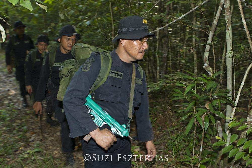Anti-poaching unit  on field patrol<br /> Way Kambas National Park, Indonesia