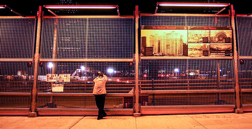 GROUND ZERO, WORLD TRADE CENTER, NEW YORK CITY - On the 3rd anniversary ceremony of the terrorist attacks on the World Trade Center towers Saturday, Sept. 11, 2004, about 5:30 a.m., a man looks out over the scene.  SEE DEVLIN STORY  (DONNA FISHER/TMC)