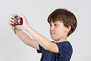 Boy of 6 with digital camera