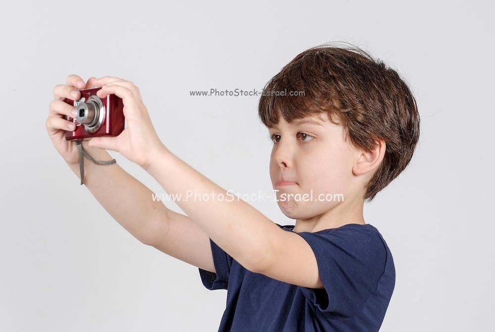 Boy of 6 with digital camera