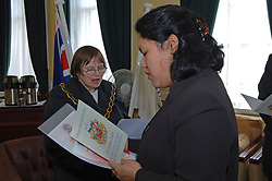 Citizenship ceremony - Woman being sworn in as a British citizen at Wallsend Town Hall; Tyneside UK 2005