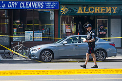 Police are photographed investigating a car with a bullet hole within the scene of a mass shooting in Toronto, Canada, on Monday, July 23, 2018. Photo by Christopher Katsarov/CP/ABACAPRESS.COM