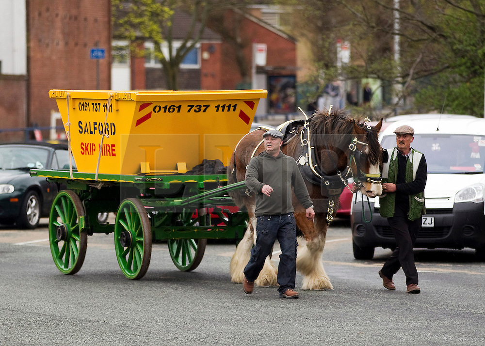 "© under license to London News Pictures. 1/4/2010: Fuel protest organiser Tony Cauchi (C), who runs local business Salford Skip Hire. A skip company owner caused tailbacks in Manchester this morning (Fri) by deciding to move one of his skip's by horse and cart. Mr Cauchi organised this morning's fuel protest, along with several other local business, over the last four months. He says the 1p reduction in fuel tax is ""no help"" and calls for a 10 pence reduction on the price of fuel. Credit should read ""Joel Goodman/LNP""."