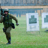 Hungarian riflemen present their military skills during a dynamic presentation during the presentation of the coalition support for Hungary by the US military in Szolnok, Hungary on July 18, 2011. ATTILA VOLGYI