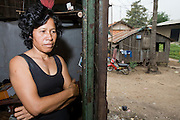 30 JUNE 2006 - PHNOM PENH, CAMBODIA: HON VOEAN, 48 years old, in her home, an abandoned boxcar in the Phnom Penh train station. Hon lost her home when her husband died and moved into the boxcar, which has been her home for six years. Hundreds of people live in the Phnom Penh rail yards, some in abandoned train cars, others in small shacks they have built near the tracks. While much of Cambodia's infrastructure has been rebuilt since the wars which tore the country apart in the late 1980s, the train system is still in disrepair. There is now only one passenger train in the country. It runs from Phnom Penh to the provincial capitol Battambang and it runs only one day a week. It takes 12 hours to complete the 190 mile journey.  Photo by Jack Kurtz / ZUMA Press