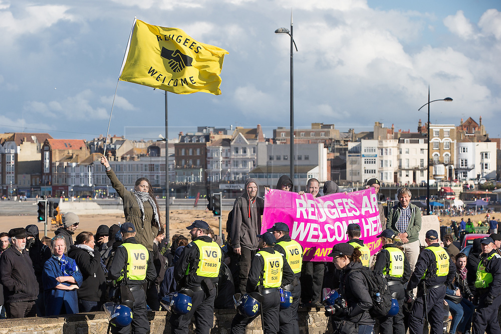 © Licensed to London News Pictures . 22/10/2016 . Margate , UK . Anti fascist protesters . A White Lives Matter protest and march , opposed by antifascists , is held in Margate , Kent . Photo credit : Joel Goodman/LNP