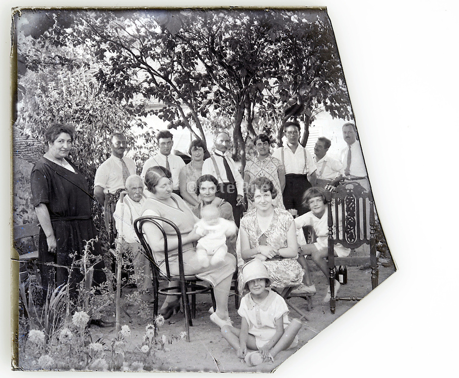 part of a glass plate with large family group 1900s