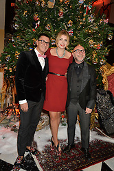 Left to right, STEFANO GABBANA, LOLA LENNOX and DOMENICO DOLCE at a party to celebrate the unveiling of the 2014 Claridge's Christmas tree by Dolce & Gabbana at Claridge's, Brook Street, London on 19th November 2014.