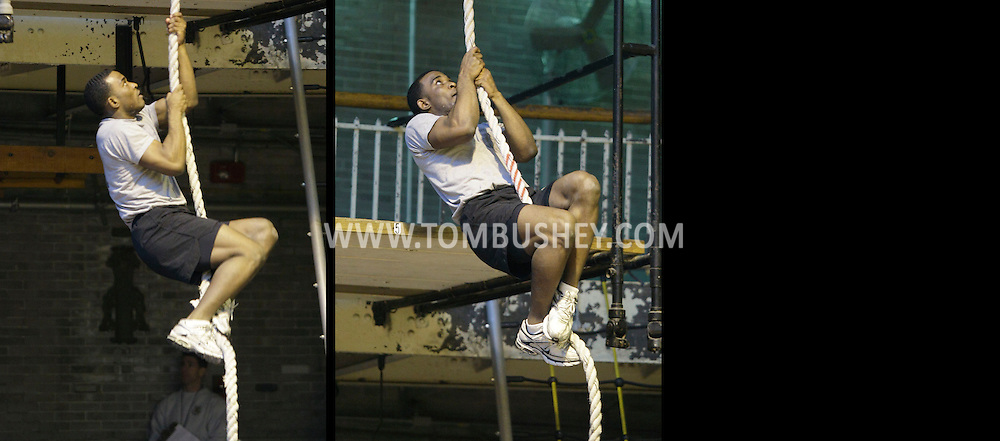 A cadet works on the rope climb during the Indoor Obstacle Course Test at Hays Gym at the U.S. Military Academy at West Point on Feb. 9, 2010.