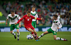 DUBLIN, REPUBLIC OF IRELAND - Friday, May 27, 2011: Wales' captain Aaron Ramsey and Northern Ireland's Oliver Norwood during the Carling Nations Cup match at the Aviva Stadium (Lansdowne Road). (Photo by David Rawcliffe/Propaganda)
