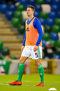 Northern Ireland defender Jonny Evans warms up before the UEFA European 2020 Qualifier match between Northern Ireland and Estonia at National Football Stadium, Windsor Park, Northern Ireland on 21 March 2019.