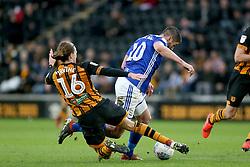 Hull City's Jackson Irvine (left) tackles Birmingham City's Lukas Jutkiewicz