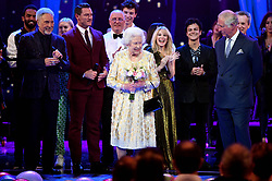 Queen Elizabeth II and the Prince of Wales with Sir Tom Jones (left), Kylie Minogue (centre right) and other performers on stage at the Royal Albert Hall in London during a star-studded concert to celebrate the Queen's 92nd birthday.