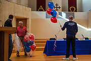 02 JULY 2012 - PARADISE VALLEY, AZ:  A man brings red, white and blue balloons into a candidate forum in Paradise Valley Monday. David Schweikert and Ben Quayle, both conservative freshmen Republican Congressmen from neighboring districts are facing each other in an August primary to see which one will represent Arizona's 6th Congressional District in 2013. The two were thrown into the same district as a result of legislative redistricting.   PHOTO BY JACK KURTZ