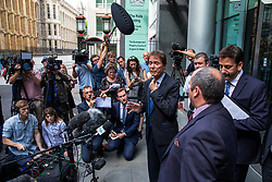 © Licensed to London News Pictures. 18/07/2018. London, UK. An emotional SIR CLIFF RICHARD (centre) as he leaves the Rolls Building of the High Court in London after winning his claim for damages against the BBC for loss of earnings. The 77-year-old singer sued the corporation after his home in Sunningdale, Berkshire was raided following allegations of sexual assault made to Metropolitan Police. Photo credit: Rob Pinney/LNP