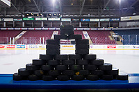 KELOWNA, BC - JANUARY 09:  A stack of pucks stand on the boards at the bench prior to warm up between the Kelowna Rockets against the Everett Silvertips at Prospera Place on January 9, 2019 in Kelowna, Canada. (Photo by Marissa Baecker/Getty Images)